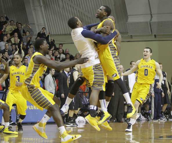 La Salle players celebrate a 54-53 victory over No. 9 Butler last week at Tom Gola Arena. Photo courtesy MCT